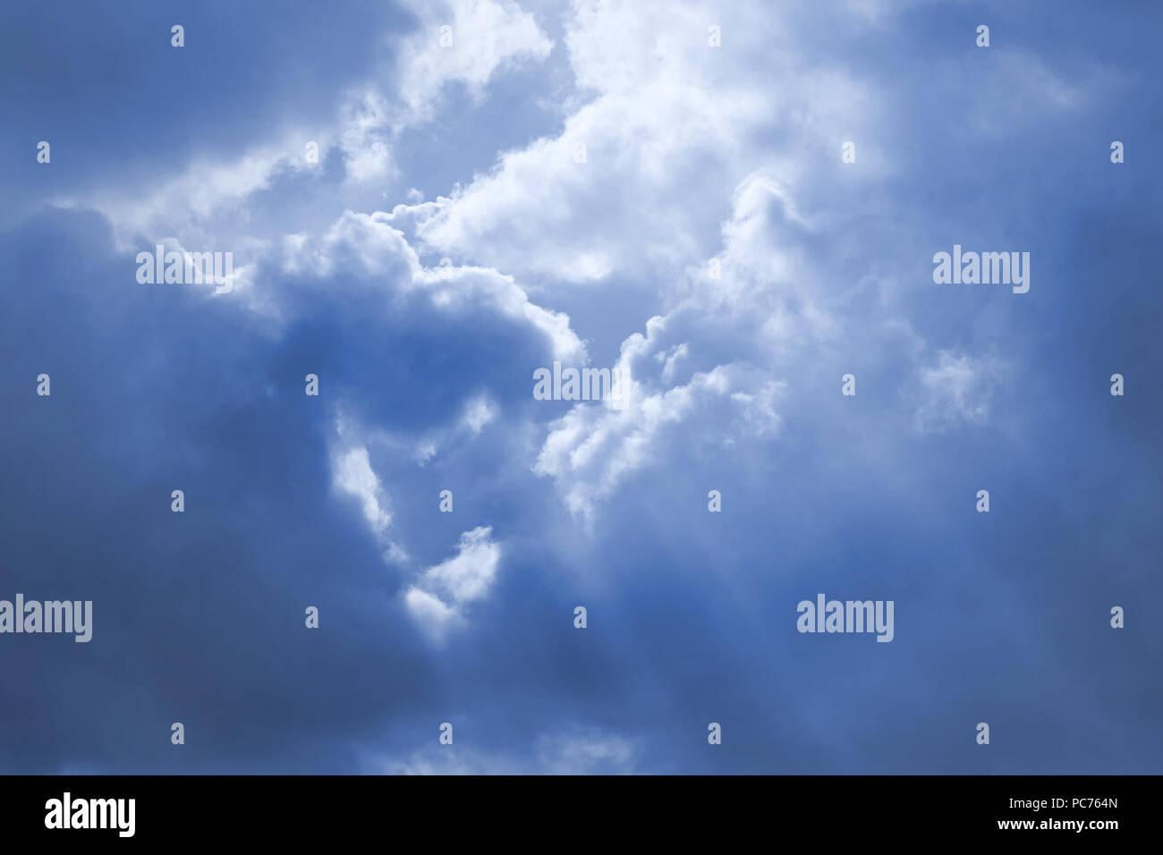 sunbeam,clouds sky - Stock Image