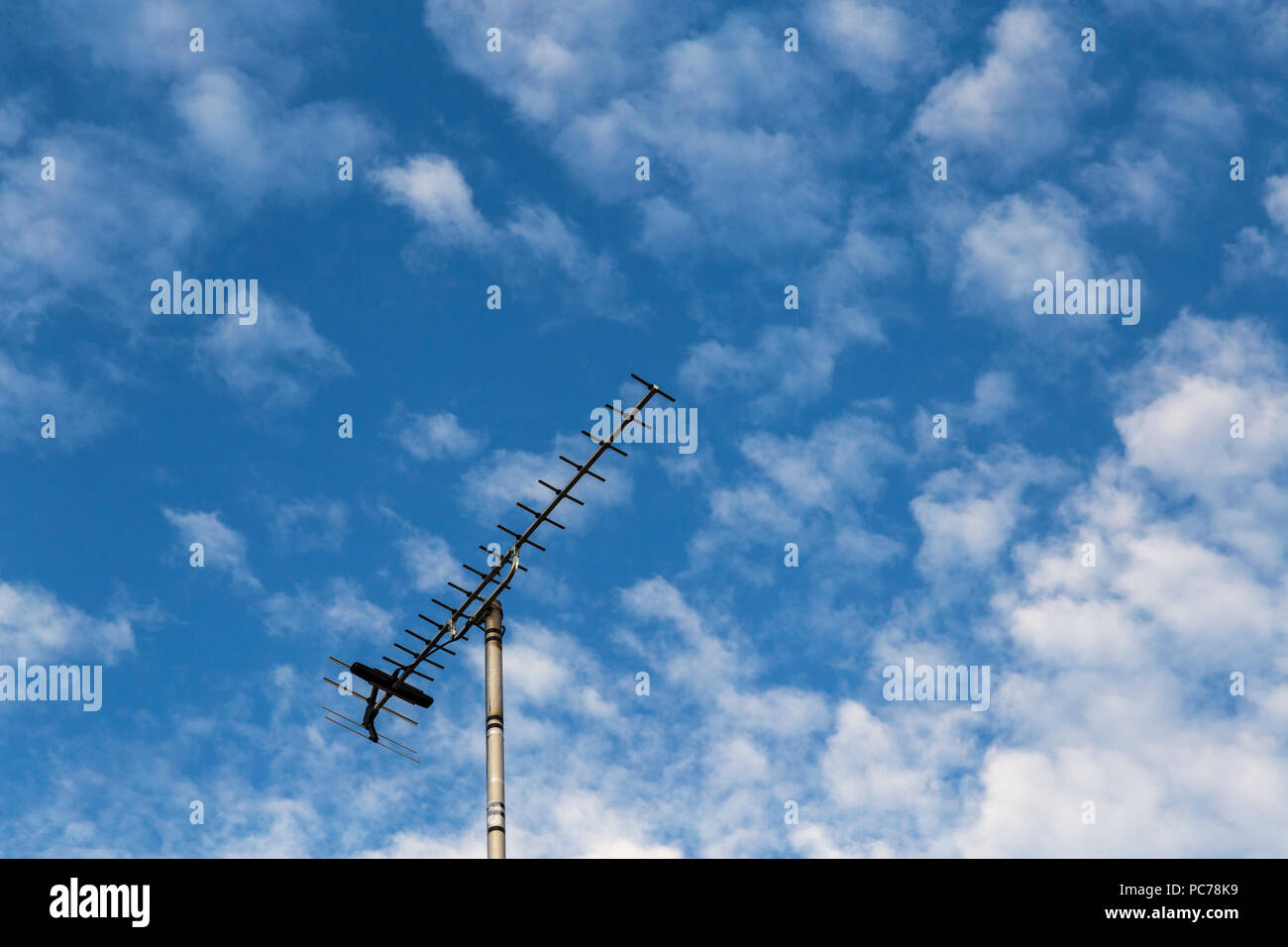 Digital Television Aerial Set Against Blue and White Sky - Stock Image