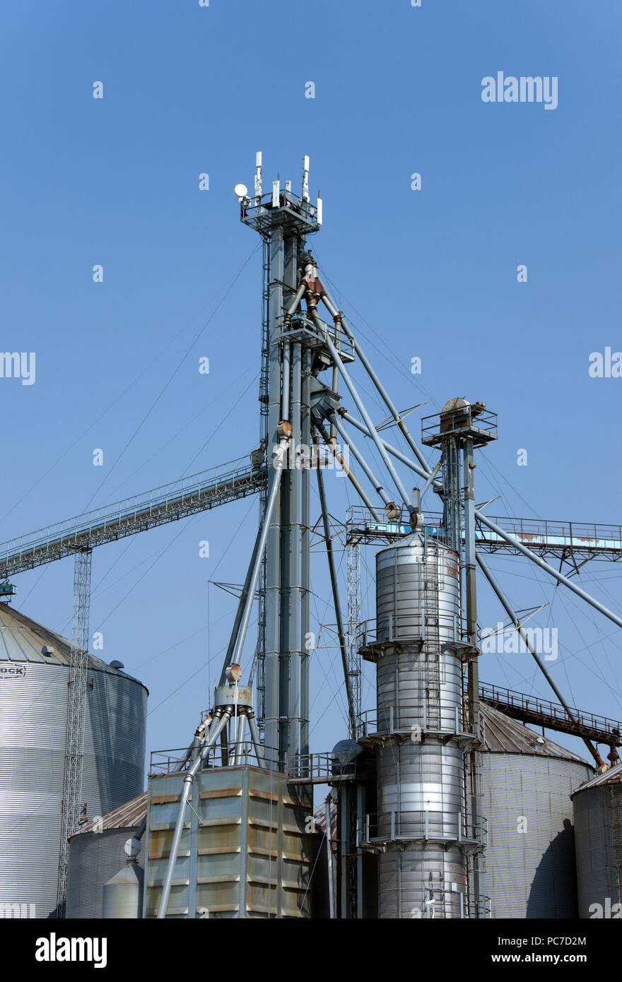Communication and internet broadband antennas on rural farm cooperative feed and grain storage, handling, conditioning system tower, Whitelaw, WI Stock Photo