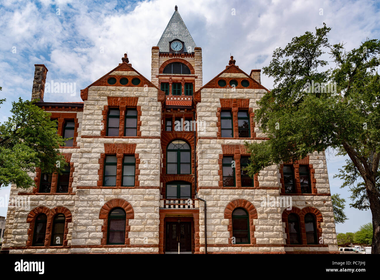 The historic 1892 Erath county courthouse in Stephenville Texas designed by James Riely Gordon in Romanesque Revival style. - Stock Image
