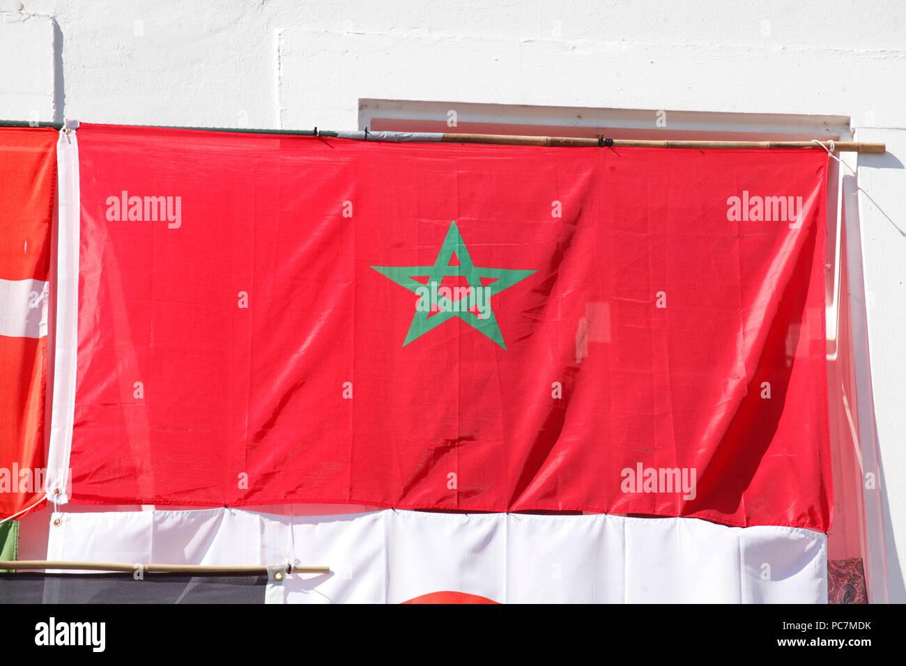 Moroccan national flag hung on a house wall, old town, Saarbruecken, Germany, Europe   I Marokkanische Nationalflagge an einer Hauswand aufgehängt, Al Stock Photo