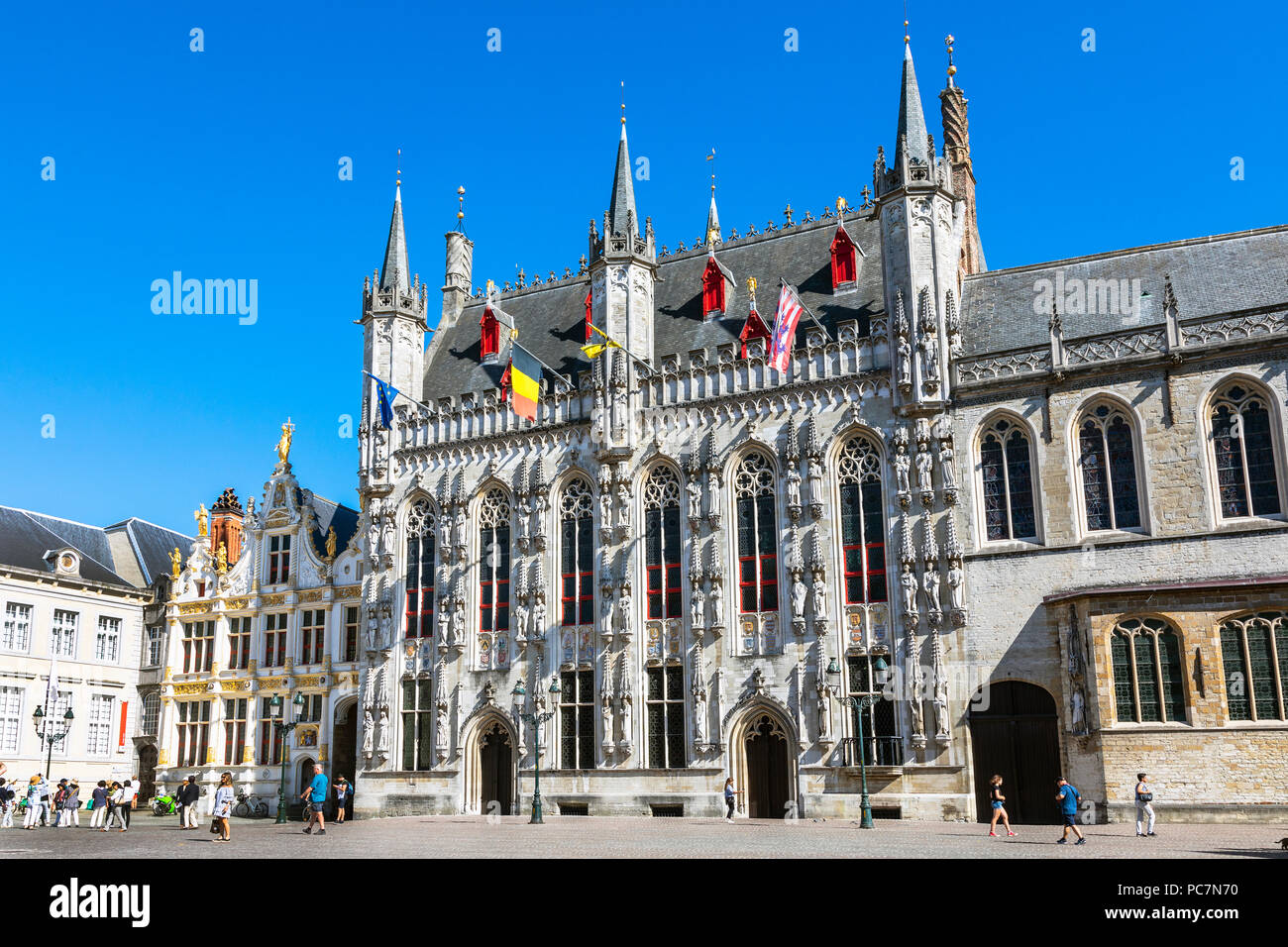 Burg Square and the city or town hall, Stadhuis city hall, Stadsbestuur Bruge, with tourists site seeing, Bruges, Belgium - Stock Image