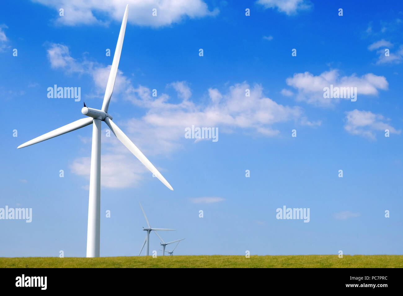 Wind turbines against a blue sky in North Wales - Stock Image