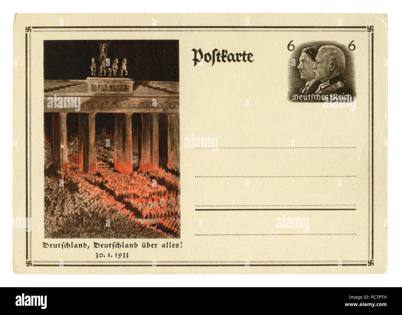 German historical postal card: Anniversary of the overthrow of power. SA troops pass by the Bradenburg gate. 30 january 1933, Germany, Third Reich - Stock Image