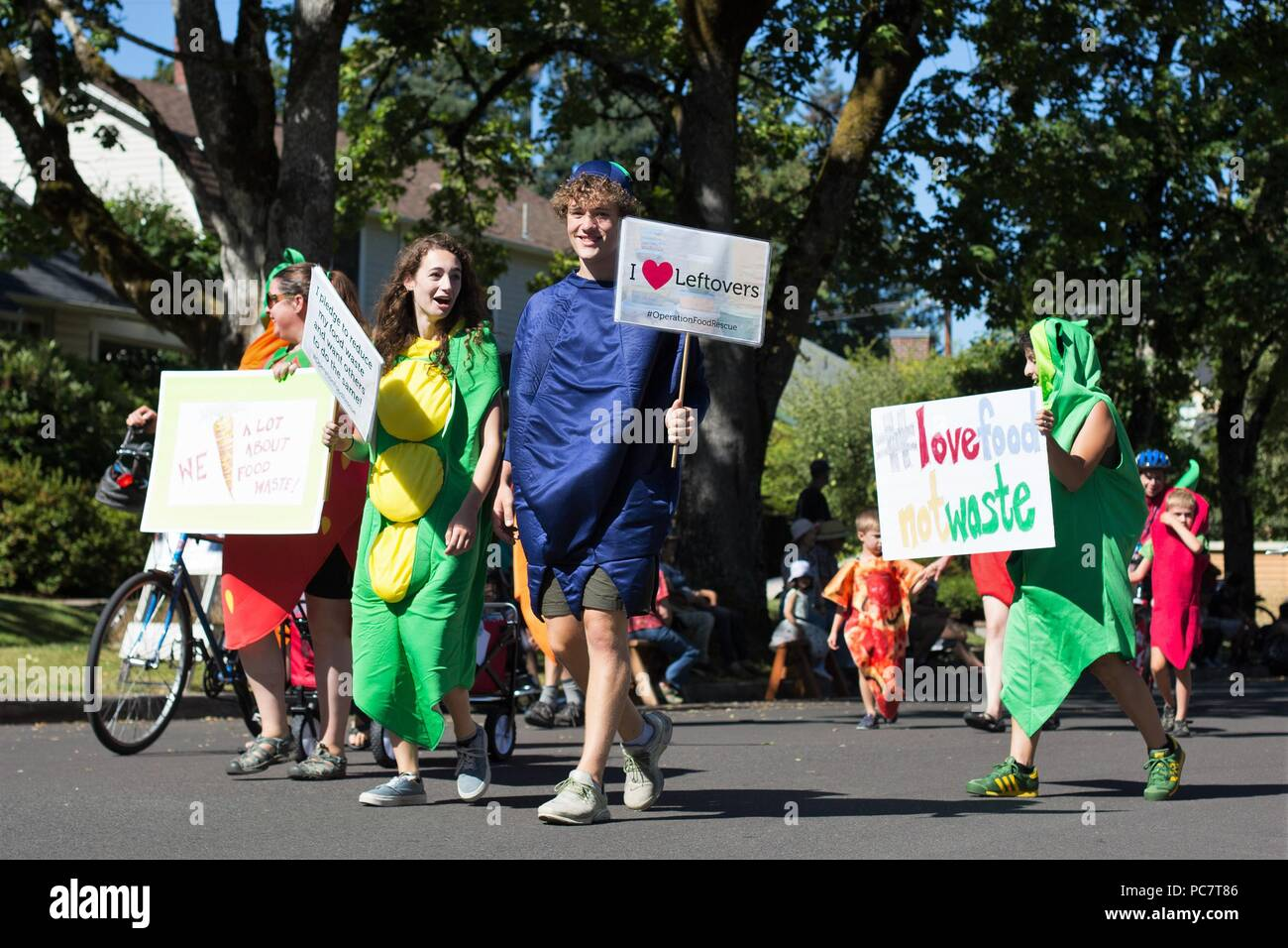 People dressed as vegetables protest food waste, at the Eug