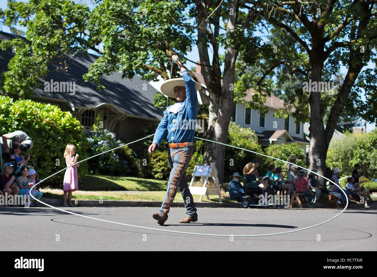 A man encircled in his own lasso, at the Eug Parade in Eugene, Oregon, USA. - Stock Image