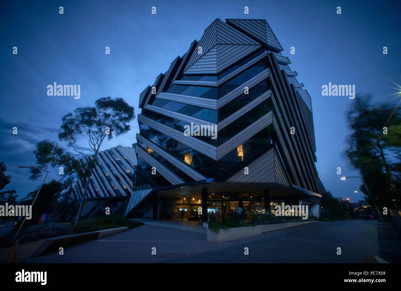 New Horizons  Research Centre, Monash University at night. - Stock Image