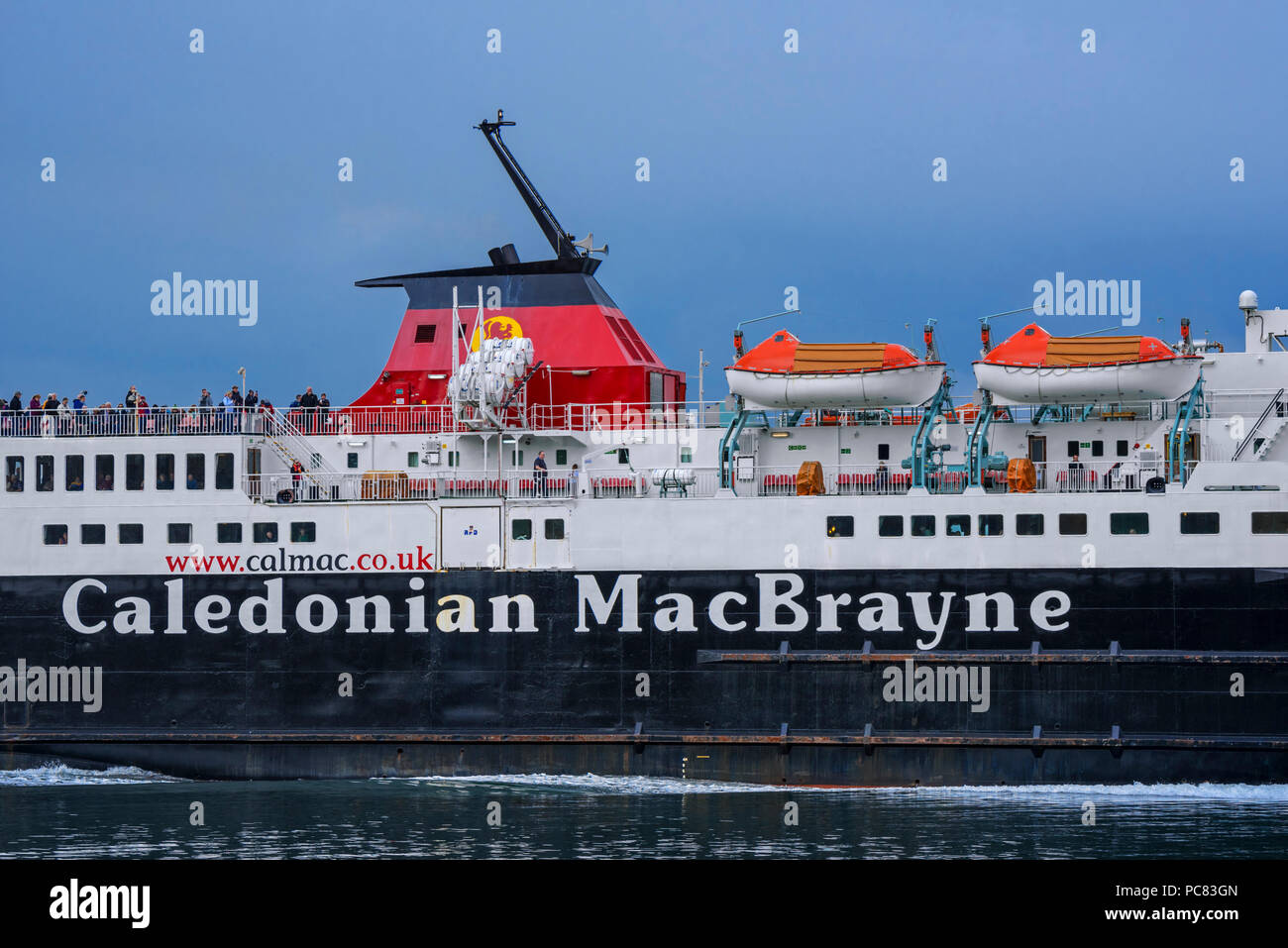 Passengers on deck of the Caledonian MacBrayne ferry boat Isle of Mull / An t-Eilean Muileach leaving the port of Oban Stock Photo