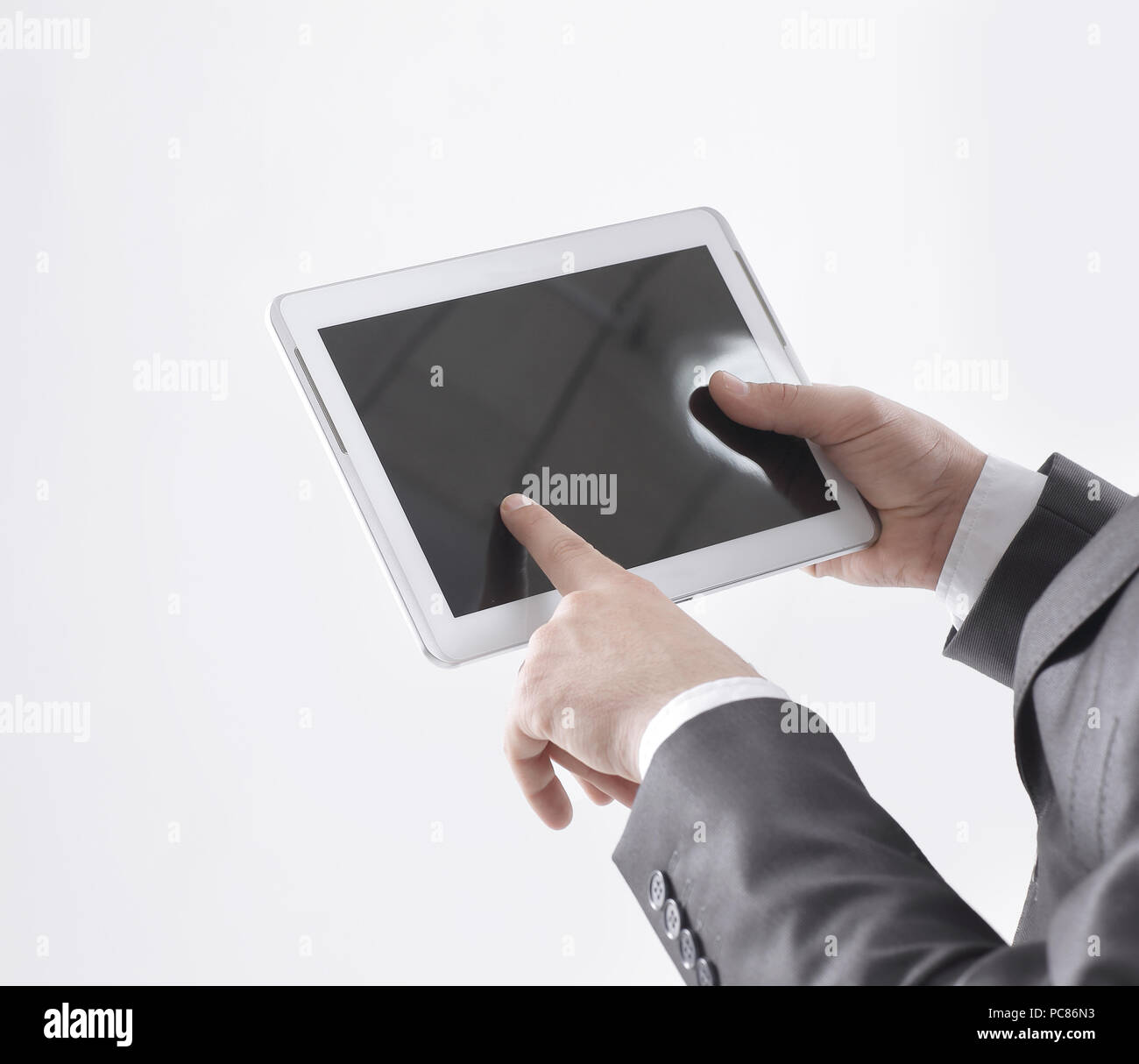close up.businessman using digital tablet.isolated on white - Stock Image