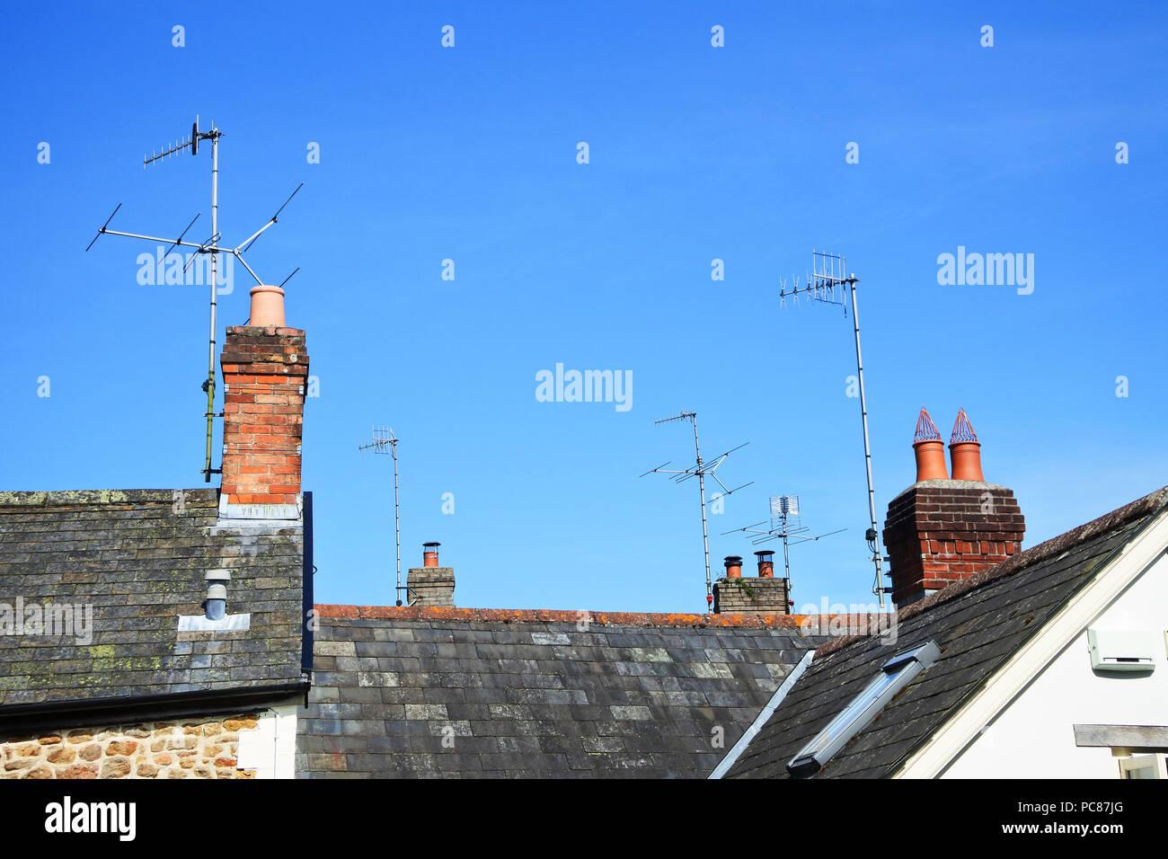 Multiple TV aerials on British rooftops - John Gollop Stock Photo