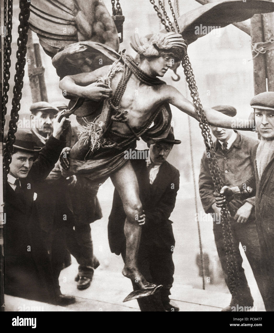 The removal of the statue of Eros from Piccadilly Circus to Embankment Gardens in 1925 during the reconstruction of Piccadilly Tube Station.  From These Tremendous Years, published 1938. - Stock Image