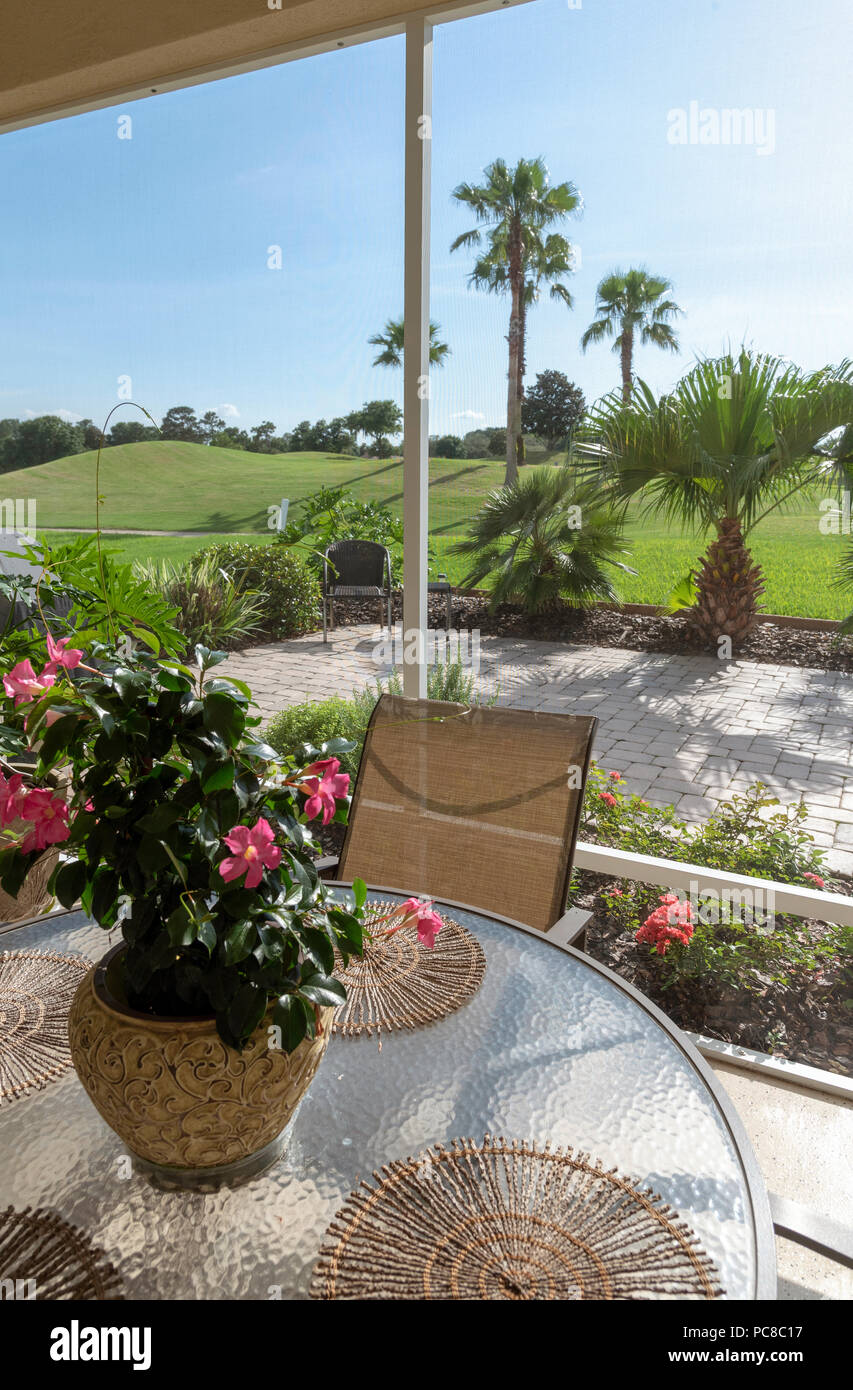 View From A Lanai Patio Through An Insect Screening Onto A Golf Course.  Florida, USA