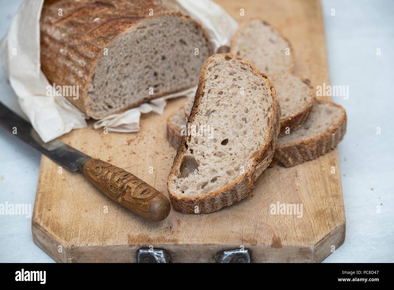 sourdough bread with a vintage bread knife on a bread board uk