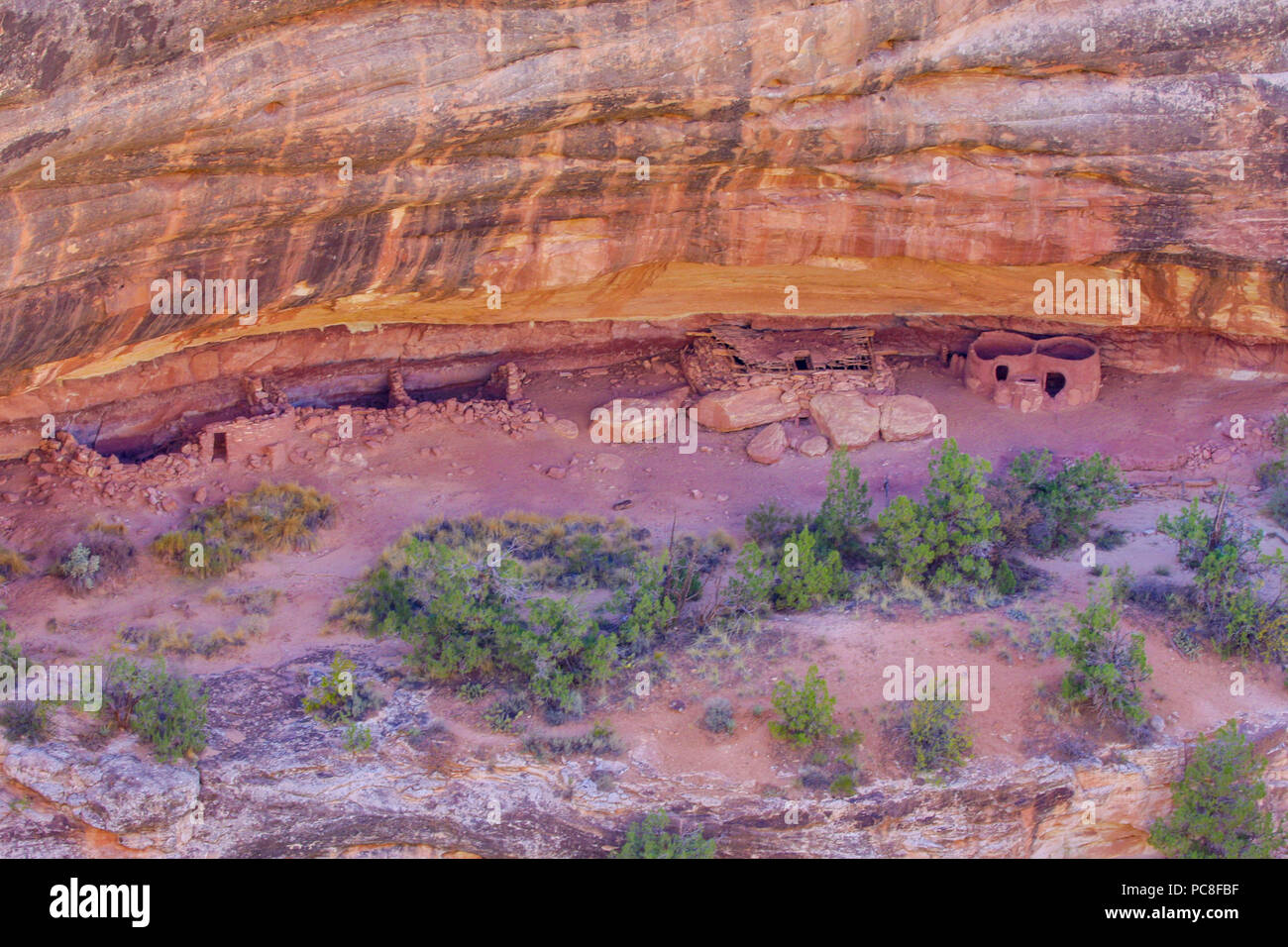 Ancient native american dwellings carved into a rock wall - Stock Image