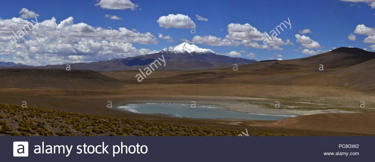A view of Volcano Uturuncu with lagoon. - Stock Image