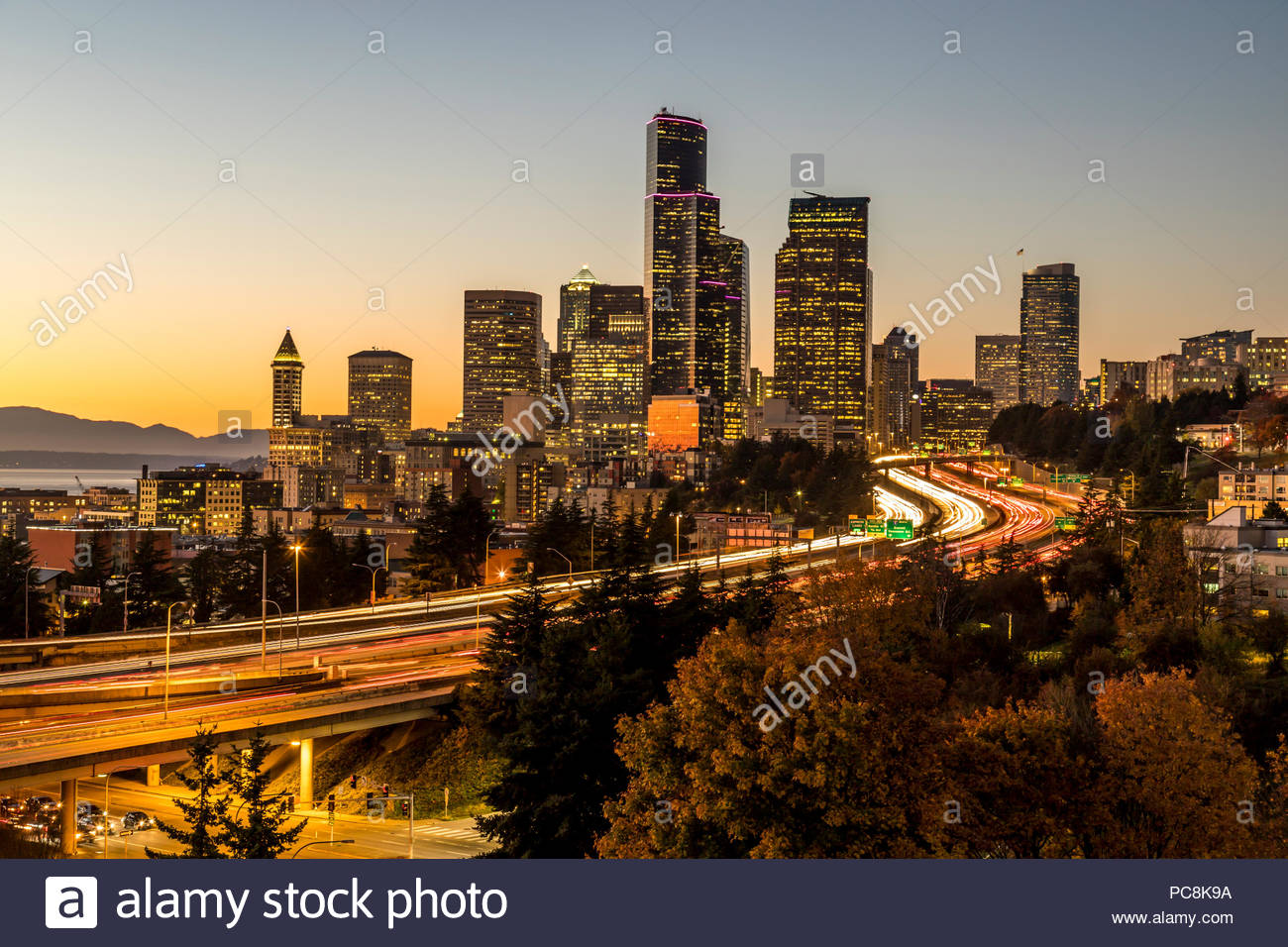 Twilight view of skyline and Interstate 5 Highway. - Stock Image
