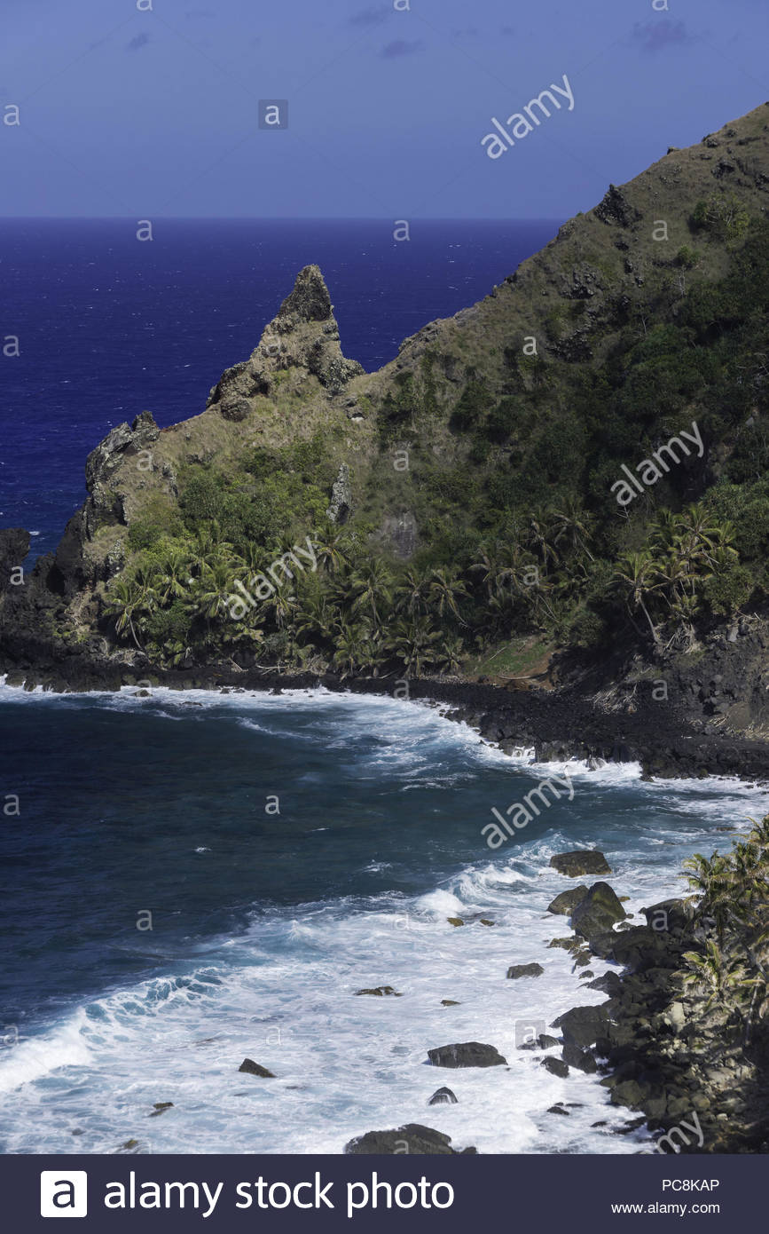 The mutineers scuttled the Bounty in Bounty Bay; today it's the only safe place to land longboats. - Stock Image
