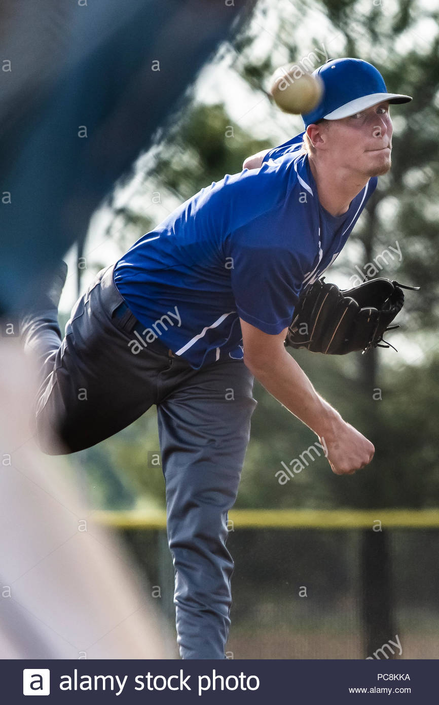 A high school boy pitches in a baseball game. Stock Photo