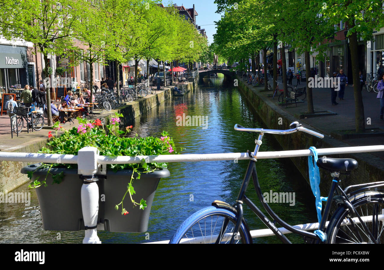 View of canal on a sunny spring day in the town centre of the stunning historic Dutch town of Delft, Holland, Netherlands Stock Photo