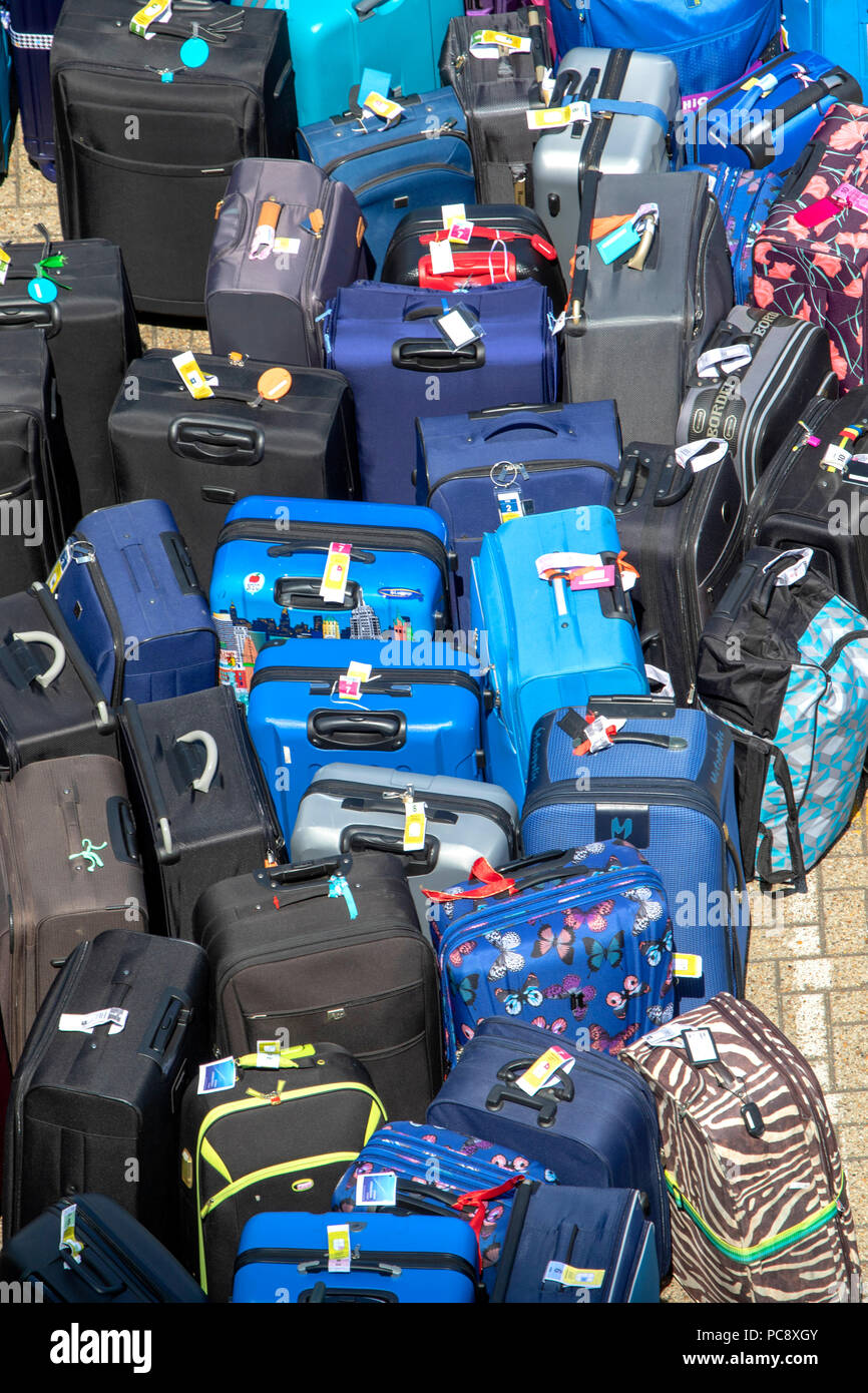 Baggage and luggage at Southampton Port, Solent, preparing the luggage to board the Independence of the Seas Cruise ship, England UK - Stock Image