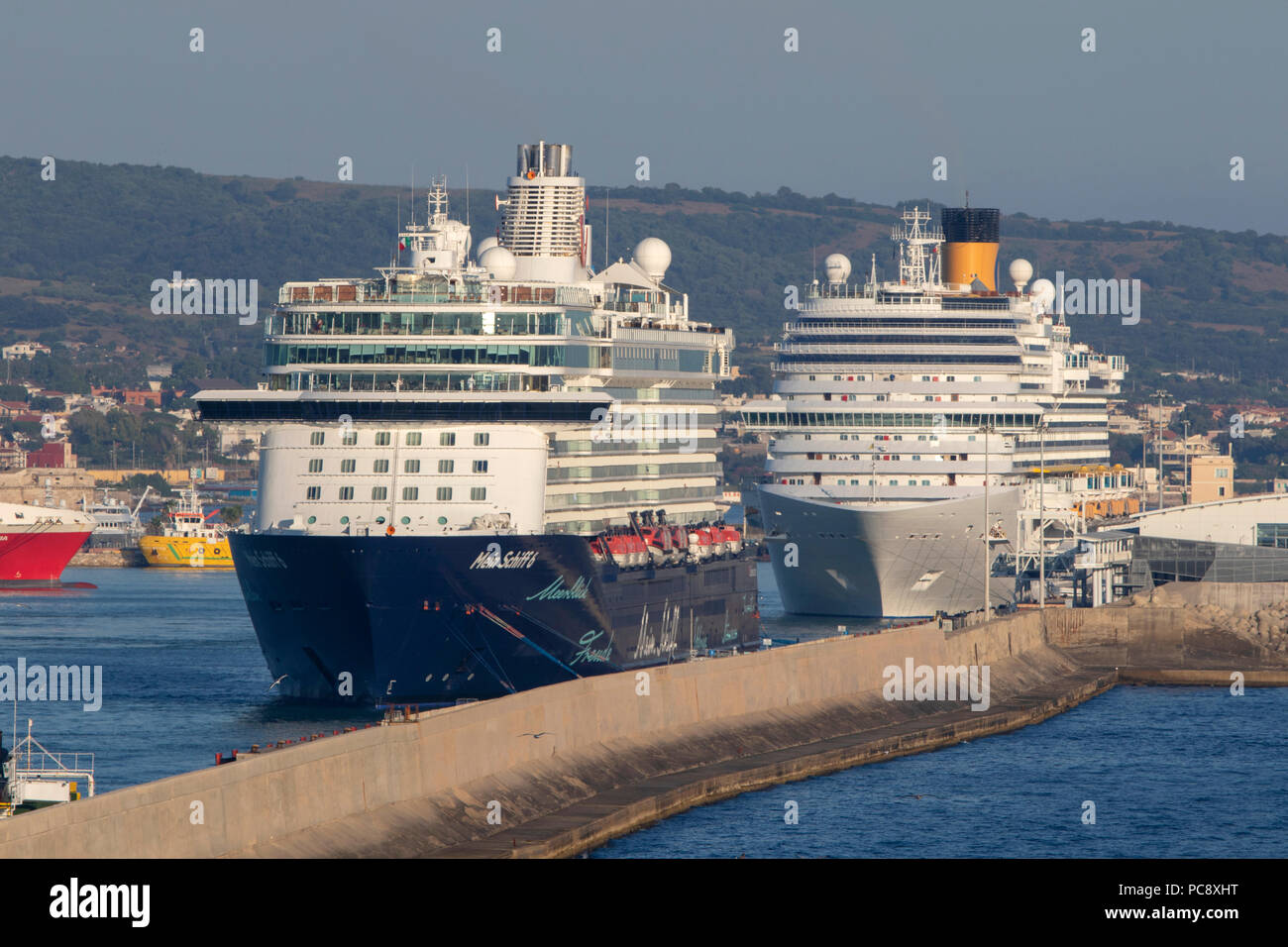 Mein Schiff 6 cruise ship owned by TUI Cruises and Costa Diadema both seen at Civitavecchia in Italy - Stock Image