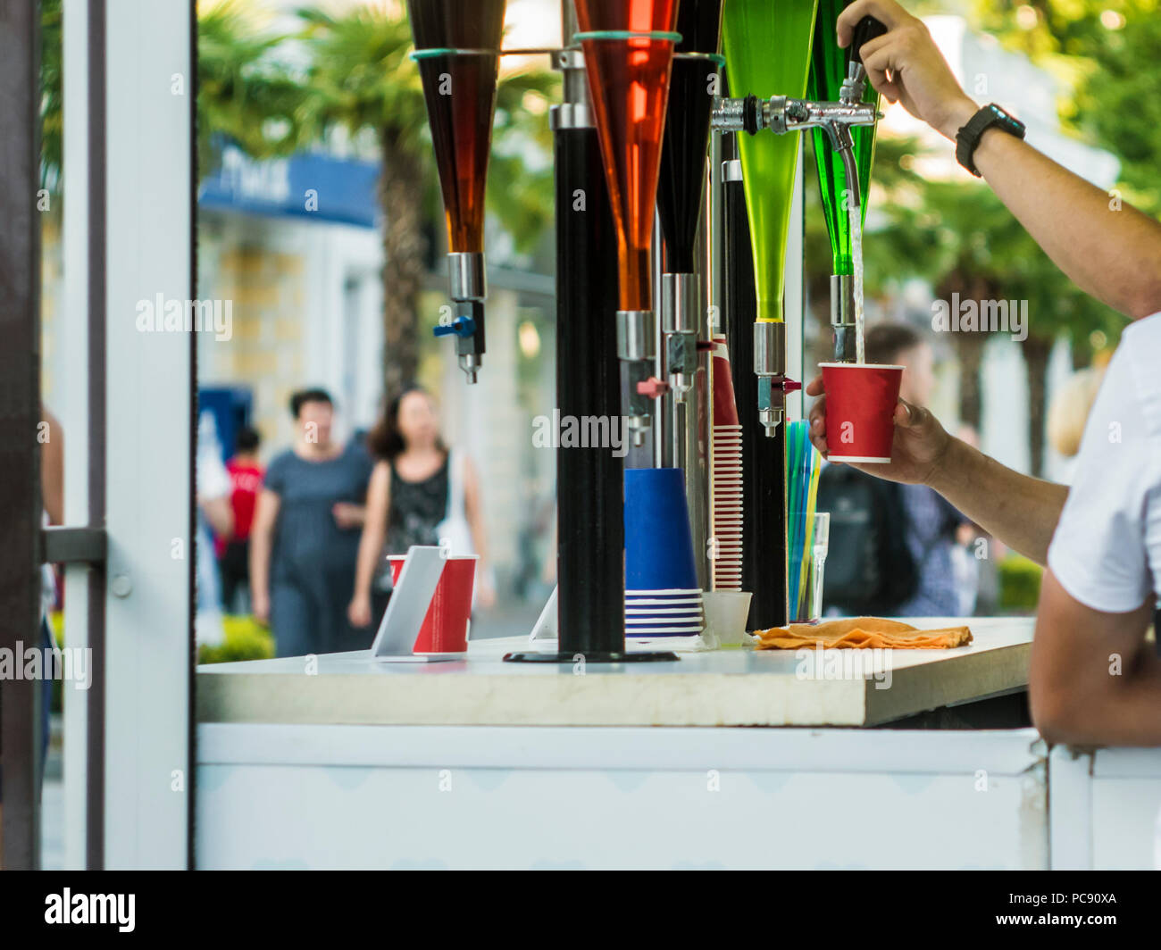 summer open air bar faucet drinks in the city street party - Stock Image
