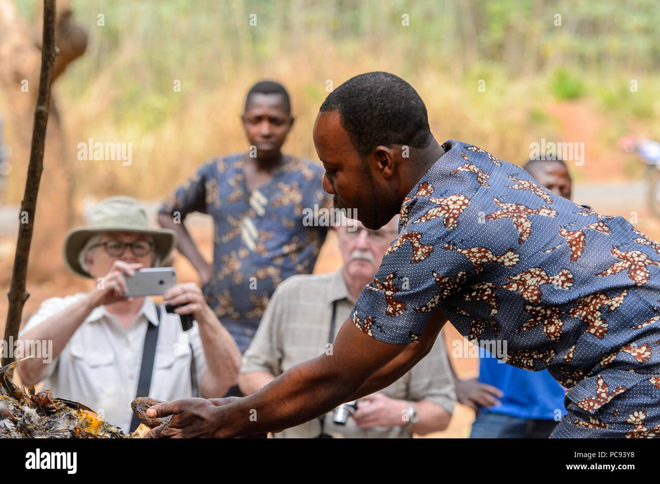 DANKOLI, BENIN - JAN 12, 2017: Unidentified Beninese man does some rituals as part of the voodoo cult. - Stock Image