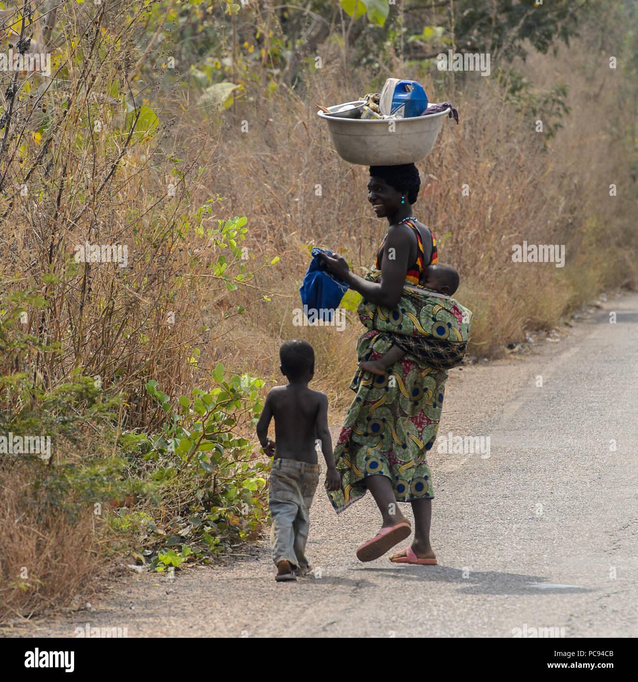 DANKOLI, BENIN - JAN 12, 2017: Unidentified Beninese woman carries a ...