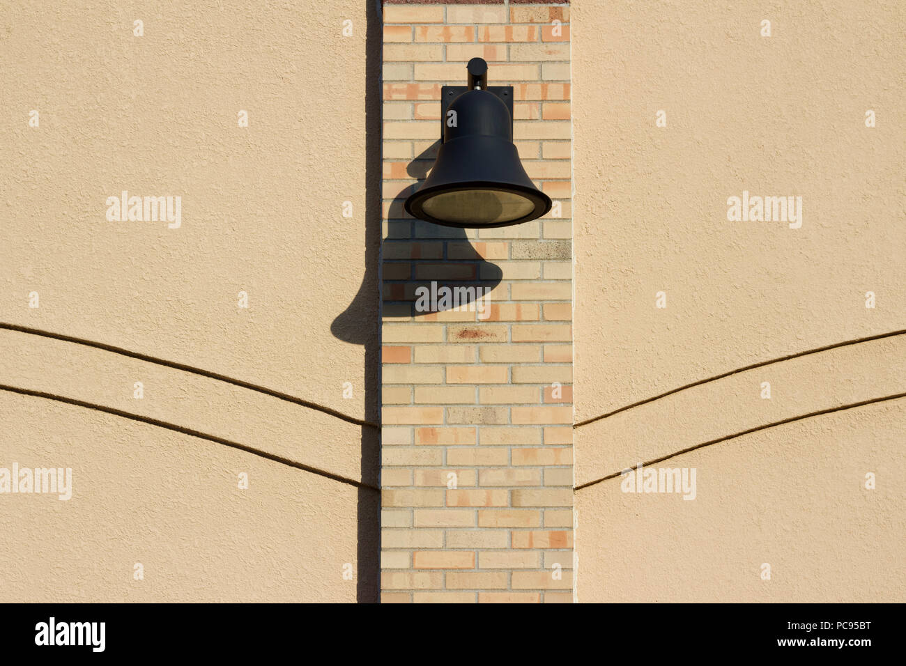 View of an attractive light colored brick and stone exterior wall ...