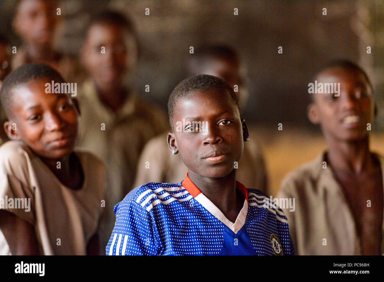 UNNAMED ROAD, TOGO - JAN 12, 2017: boy on the lesson in a local primary school. All subjects are in French language in Togo - Stock Image