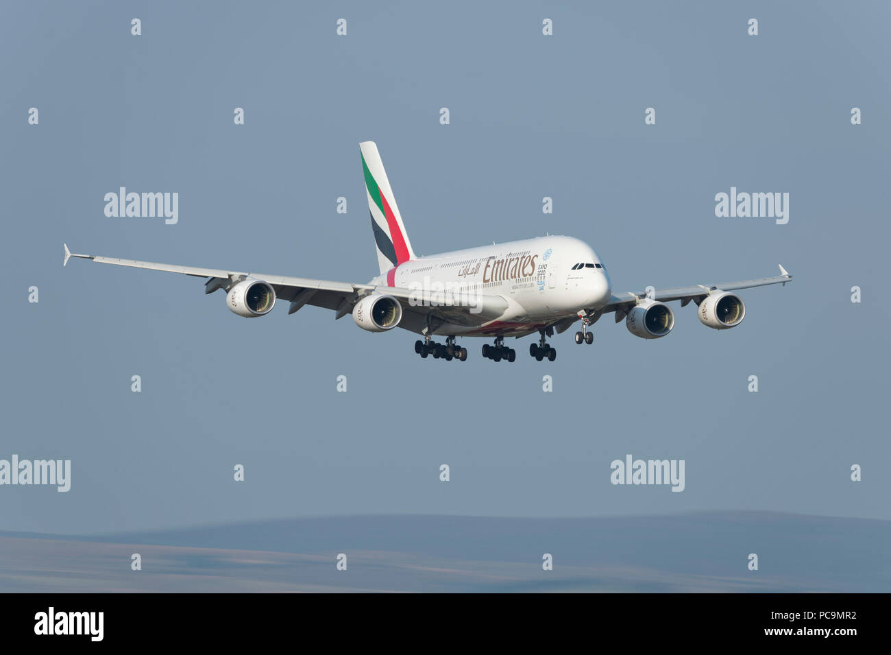 An Emirates Airbus A380-861 comes in to land at Manchester Airport, UK. - Stock Image