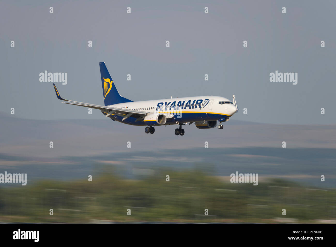 An Ryanair Boeing 737-8AS comes in to land at Manchester Airport, UK. - Stock Image