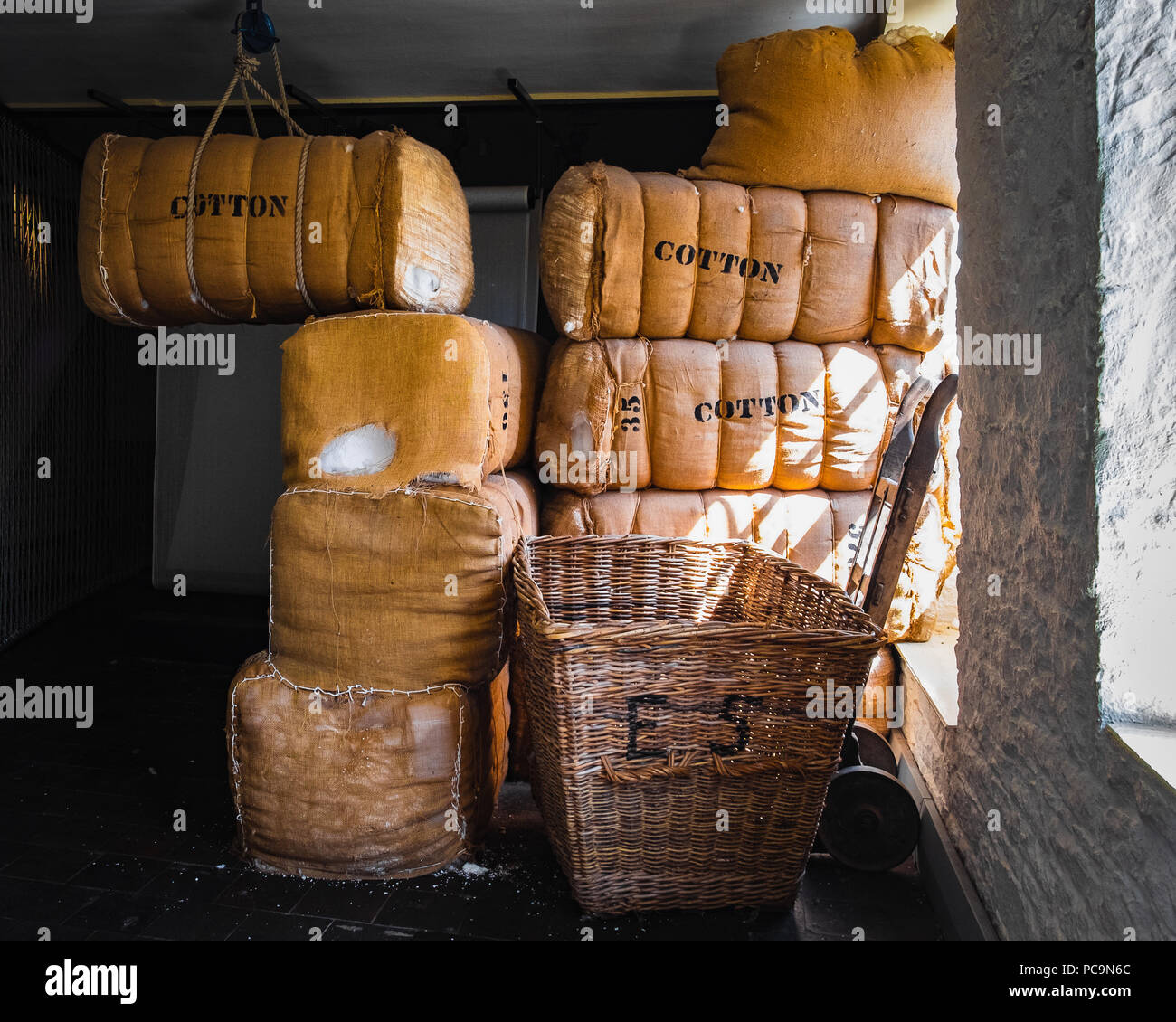 Large bales of cotton in the warehouse room - Stock Image