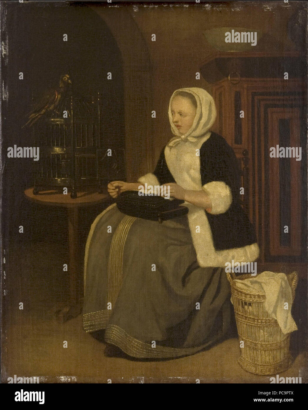 After Gabriel Metsu - Young Lady Sewing Cat507. Stock Photo