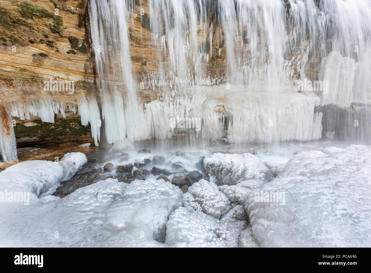 Frozen Cascade Falls, early April, Osceola, WI, USA, by Dominique Braud/Dembinsky Photo Assoc - Stock Image