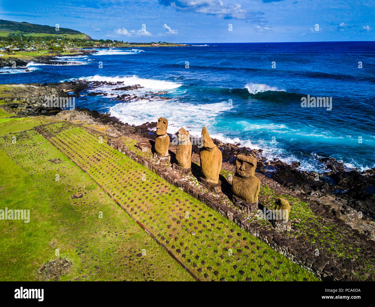 An Aerial View over Ahu Tahai alone Moai at Hanga Roa, Easter Island. This is the only one with painted eyes like it was on the past. - Stock Image