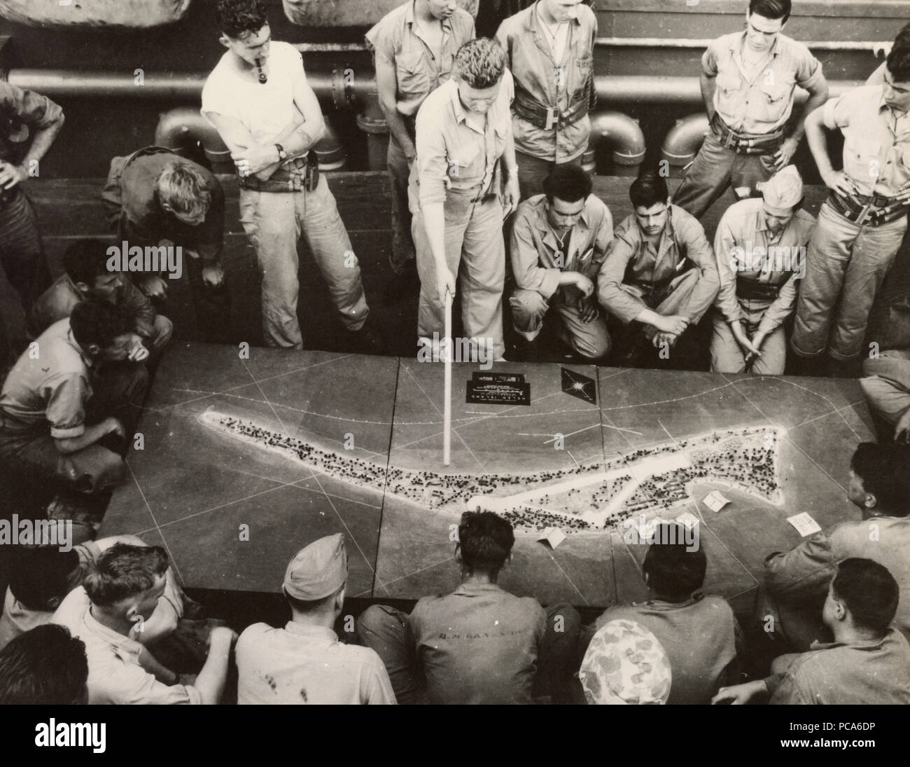 Marines study a relief model of Tarawa Atoll a few days before battle. Created by 2nd divison marines Relief Mapping Section. - Stock Image