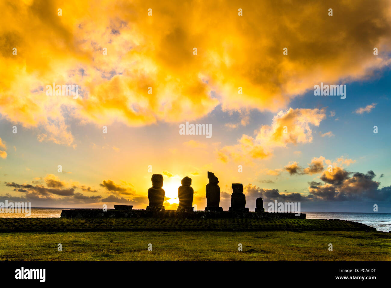 Ahu Tahai alone Moai at Hanga Roa, Easter Island. This is the only one with painted eyes like it was on the past. - Stock Image