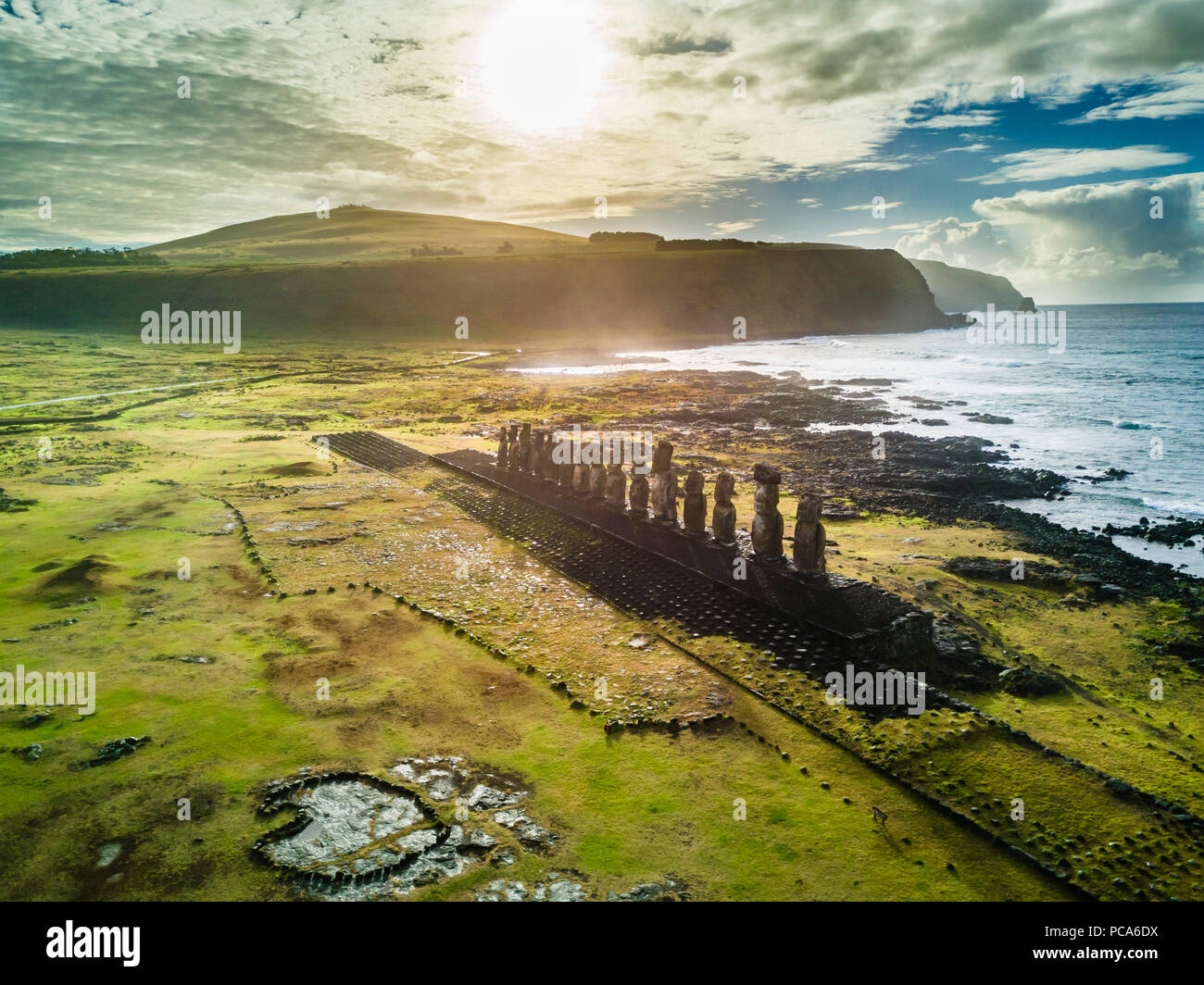 An aerial view over Ahu Tongariki, the most amazing Ahu platform on Easter Island. 15 moais still stand up at the south east of the Island. Ahu Tongar - Stock Image