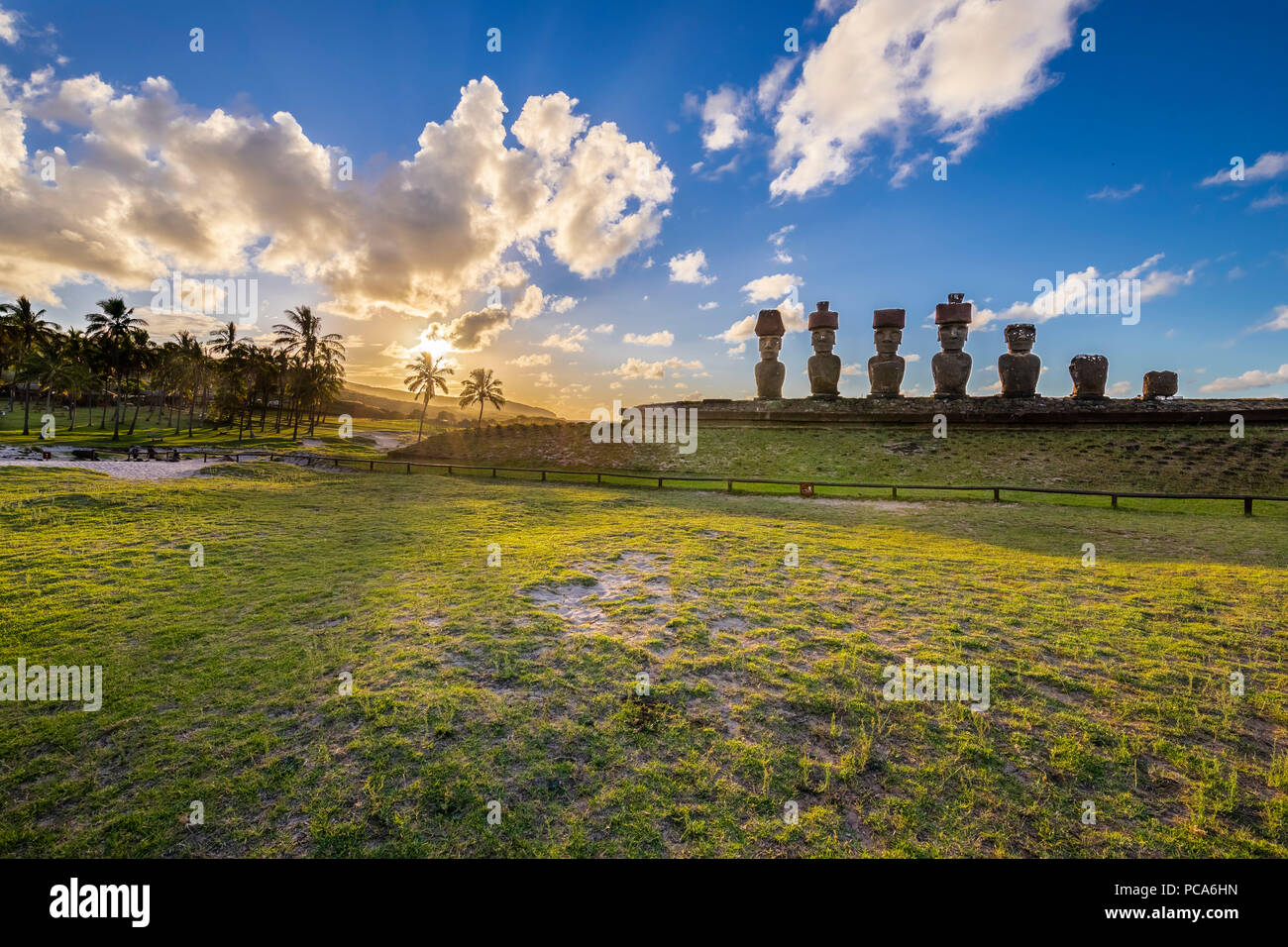Anakena Beach the most famous beach at Easter Island and maybe the best one in Chile. With it palm trees coming from Polynesia islands and the Ahu Nau - Stock Image
