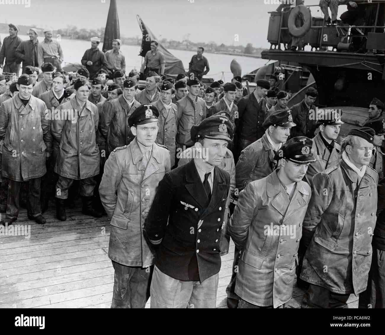Officers and Crew of Surrendered Kriegsmarine U-1228 Stand on the Tug's Deck Prior to Debarking at Portsmouth, New Hampshire  5 17 1945 Stock Photo
