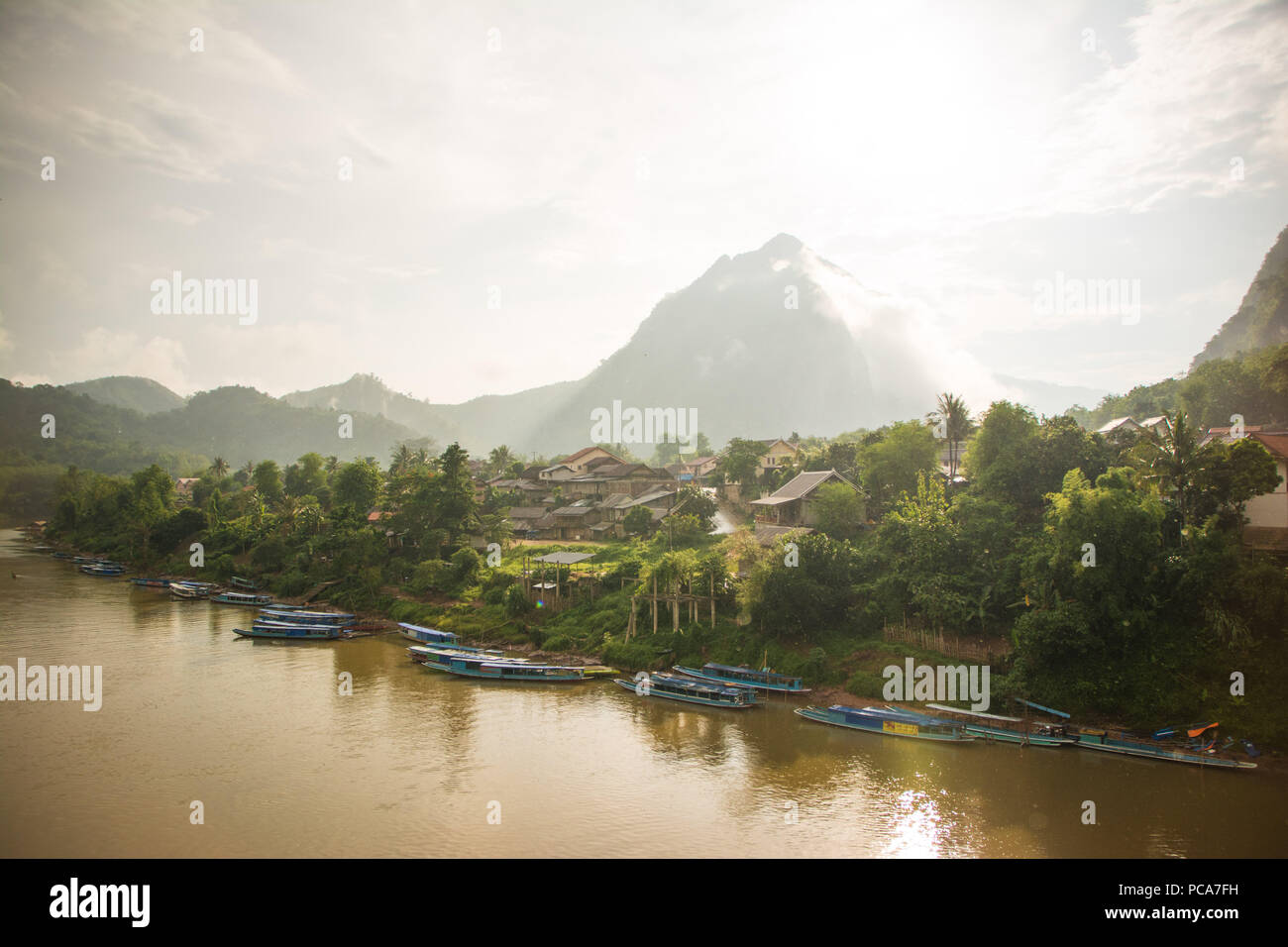 The village of Nong Khiaw at sunset after the rain. - Stock Image