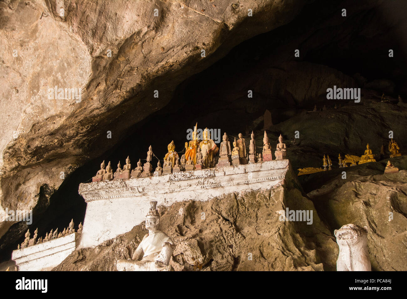 Array of golden buddhist statues in Pak Ou Caves close to Luang Prabang, Laos PDR - Stock Image