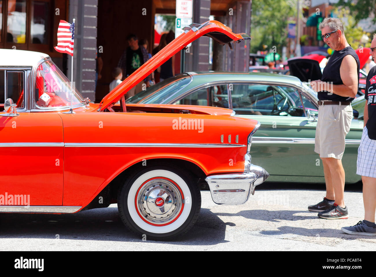 Admiring the cars at the East Passyunk Car Show and Street Festival - Stock Image