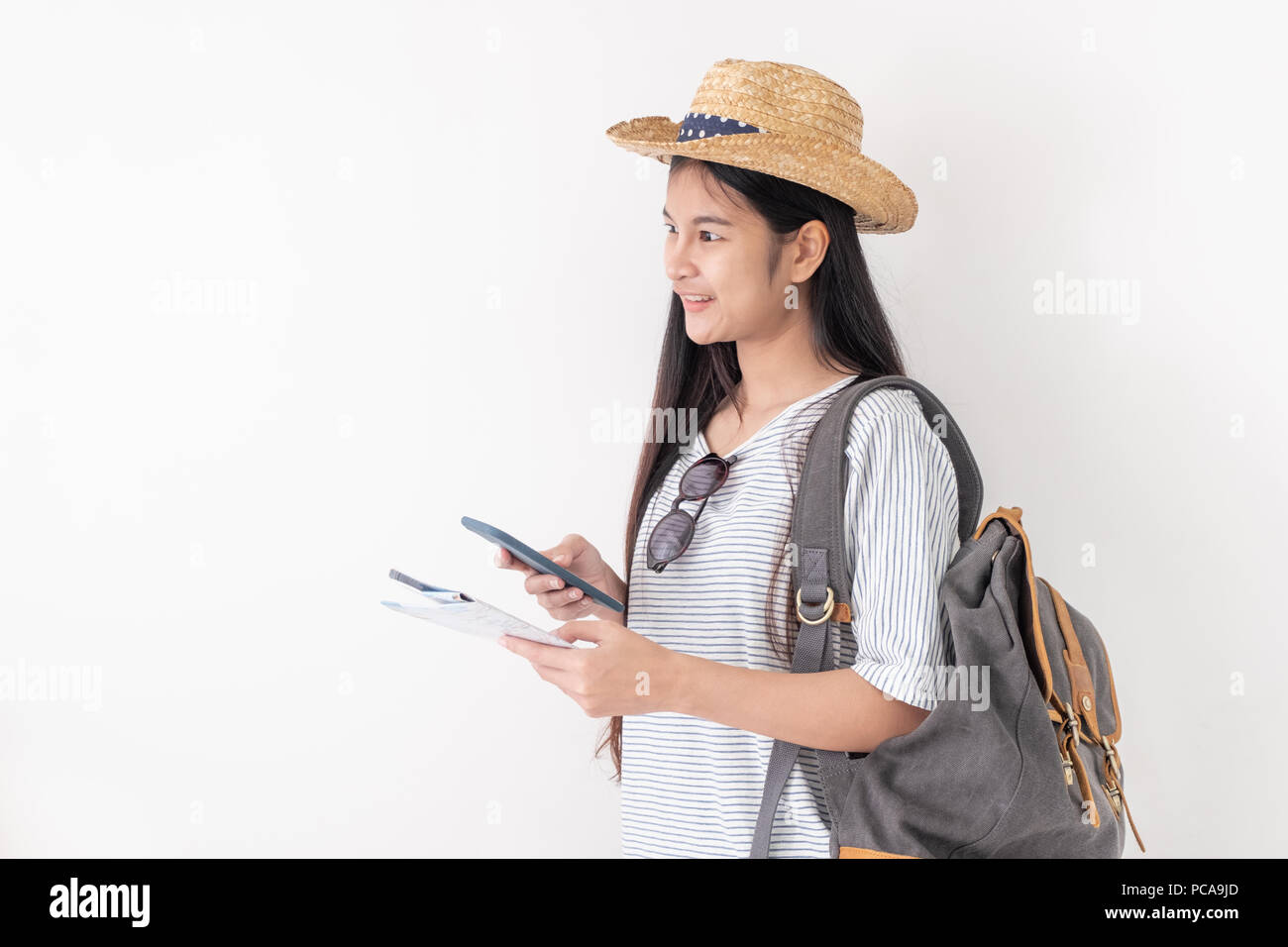 Asian woman traveler backpacker use map and mobile phone app