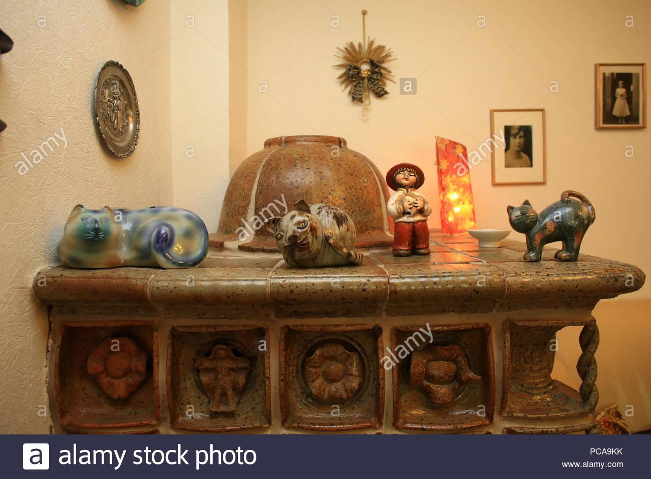 Ceramic tiled stove in a sitting room in Bavaria, Germany. - Stock Image