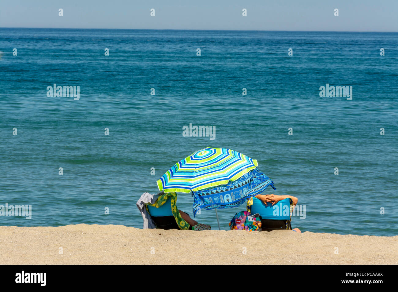 Sunbathers on the beach of Le Barcares,  Pyrenees-Orientales Department, Occitanie, France - Stock Image