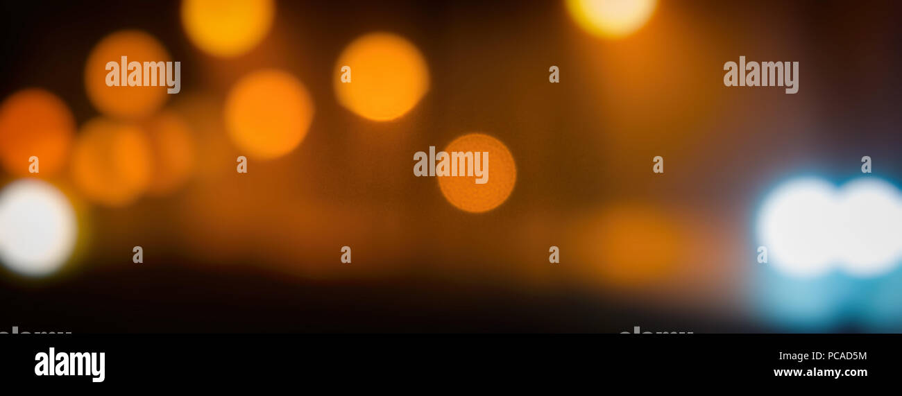Blurred background. A view of the night city with lanterns. Web banner. Element of design - Stock Image