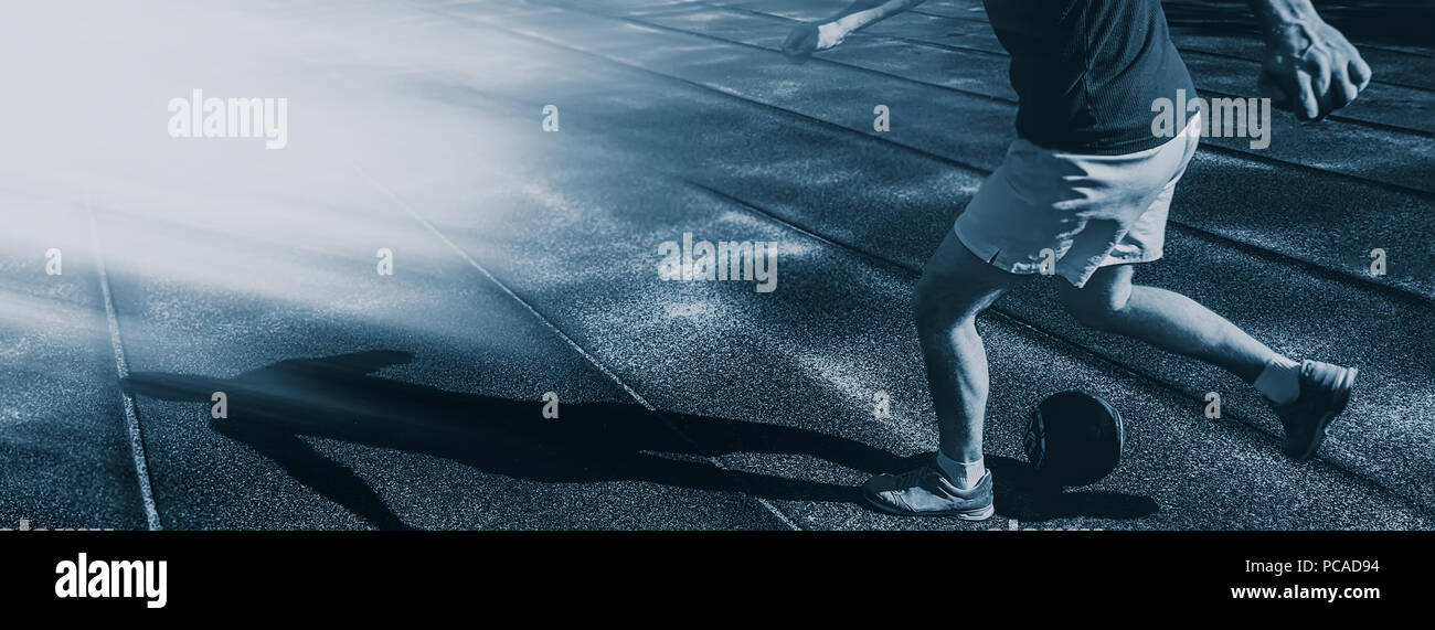 athlete a football player trains with a ball. Web banner. Element of design. - Stock Image