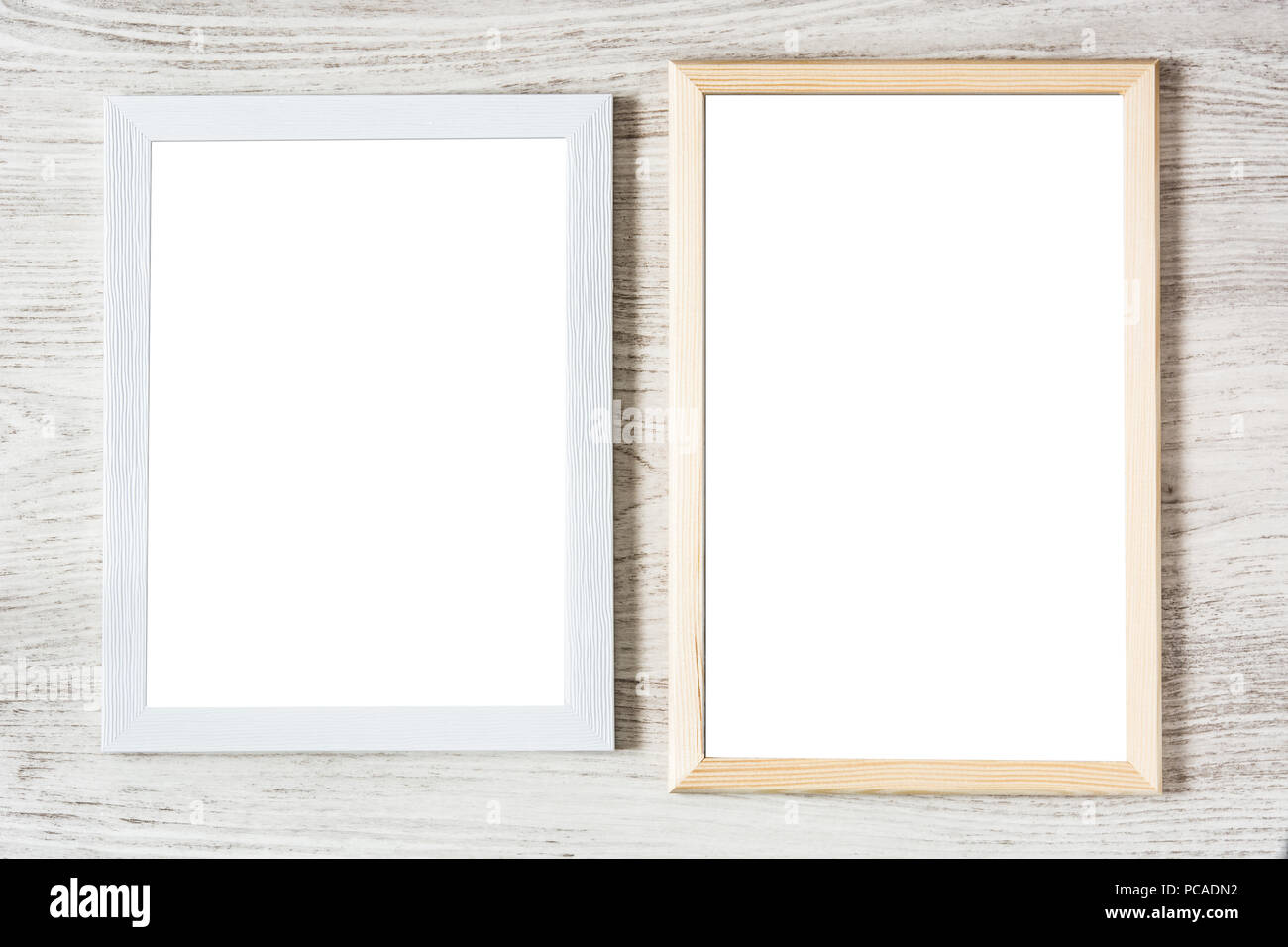Frame mockup on white wooden table. Top view Stock Photo ...